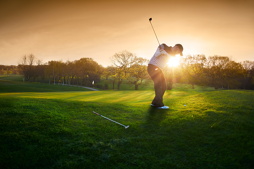 Golfer enjoying the game on a quiet golf course. Customize a specialty vacation package to match your interests.