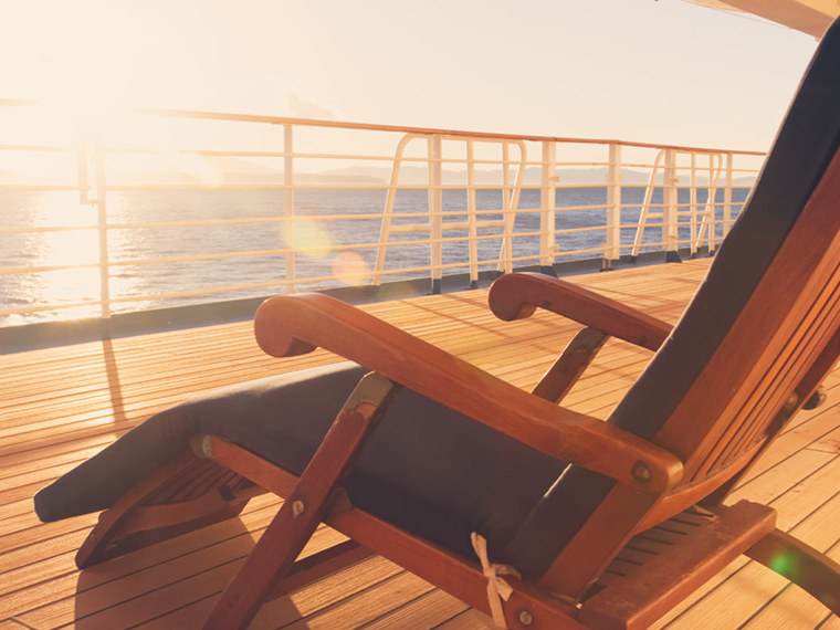 Cruiseship deck chair enjoying a sunrise alone. Packing tips from expert cruisers.