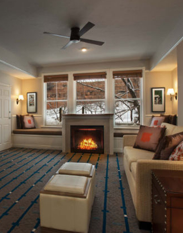 A spacious vacation villa with a fireplace and view of a snowy winter land outside.