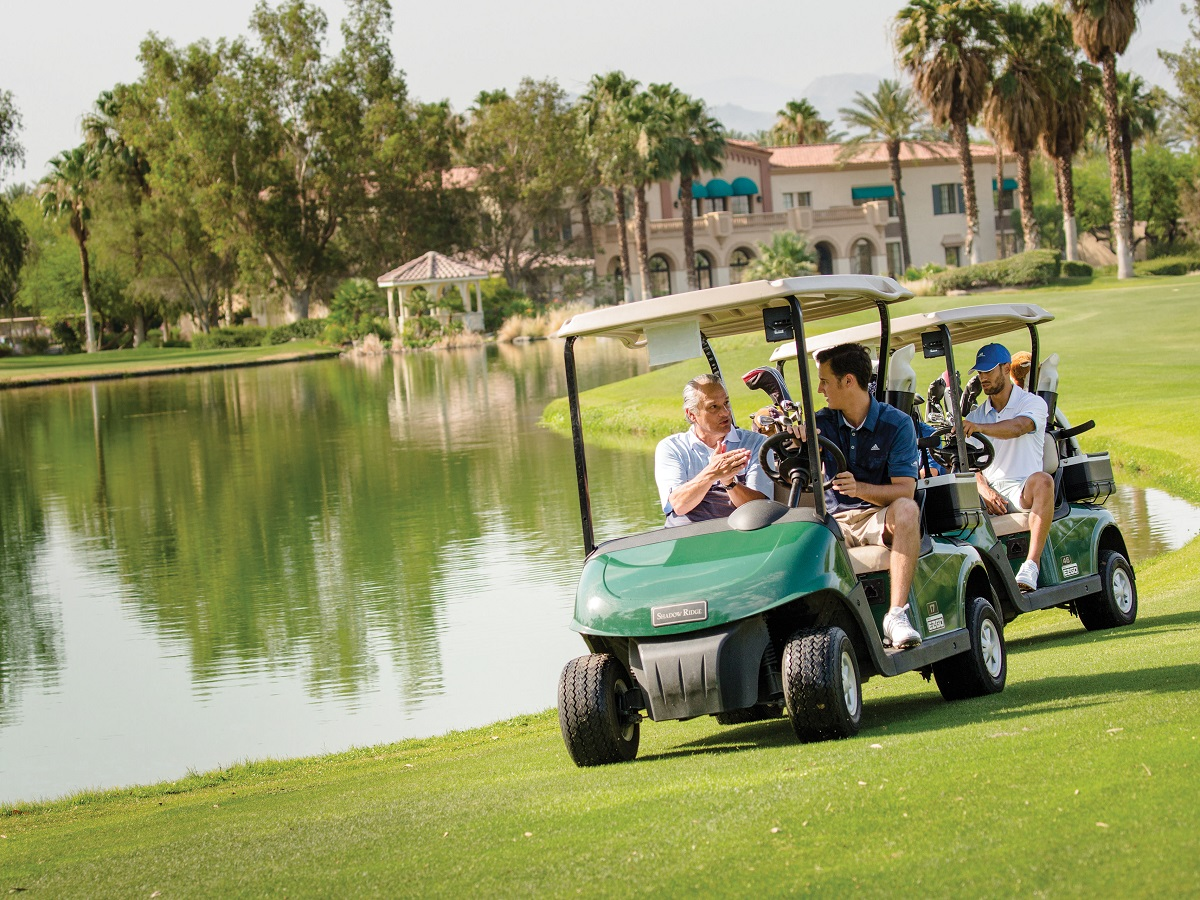 Golfers driving their golf carts on vacation.