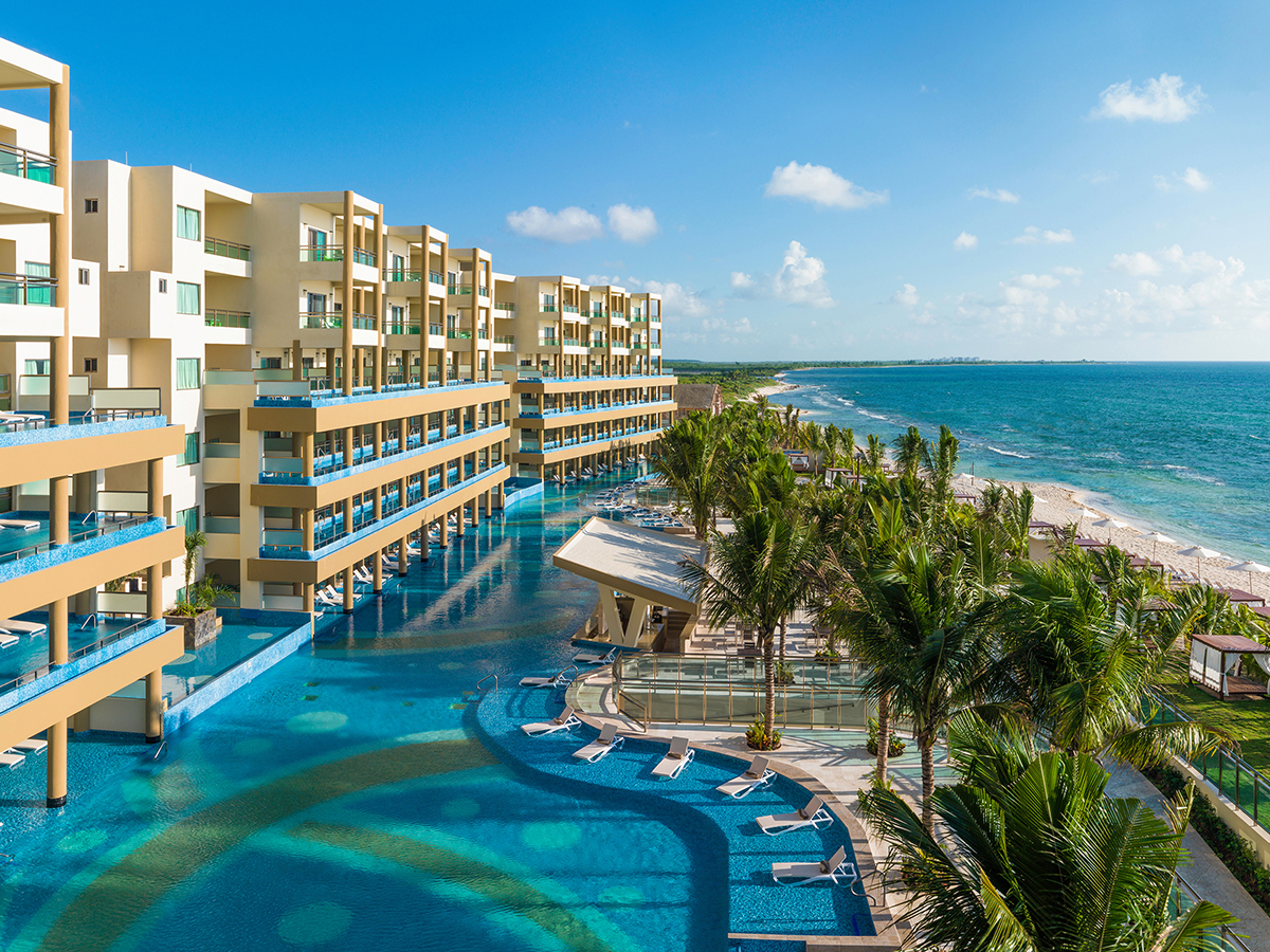 View of pool balconies and beach at Generations Riviera Maya family resort near Cancun, Mexico.