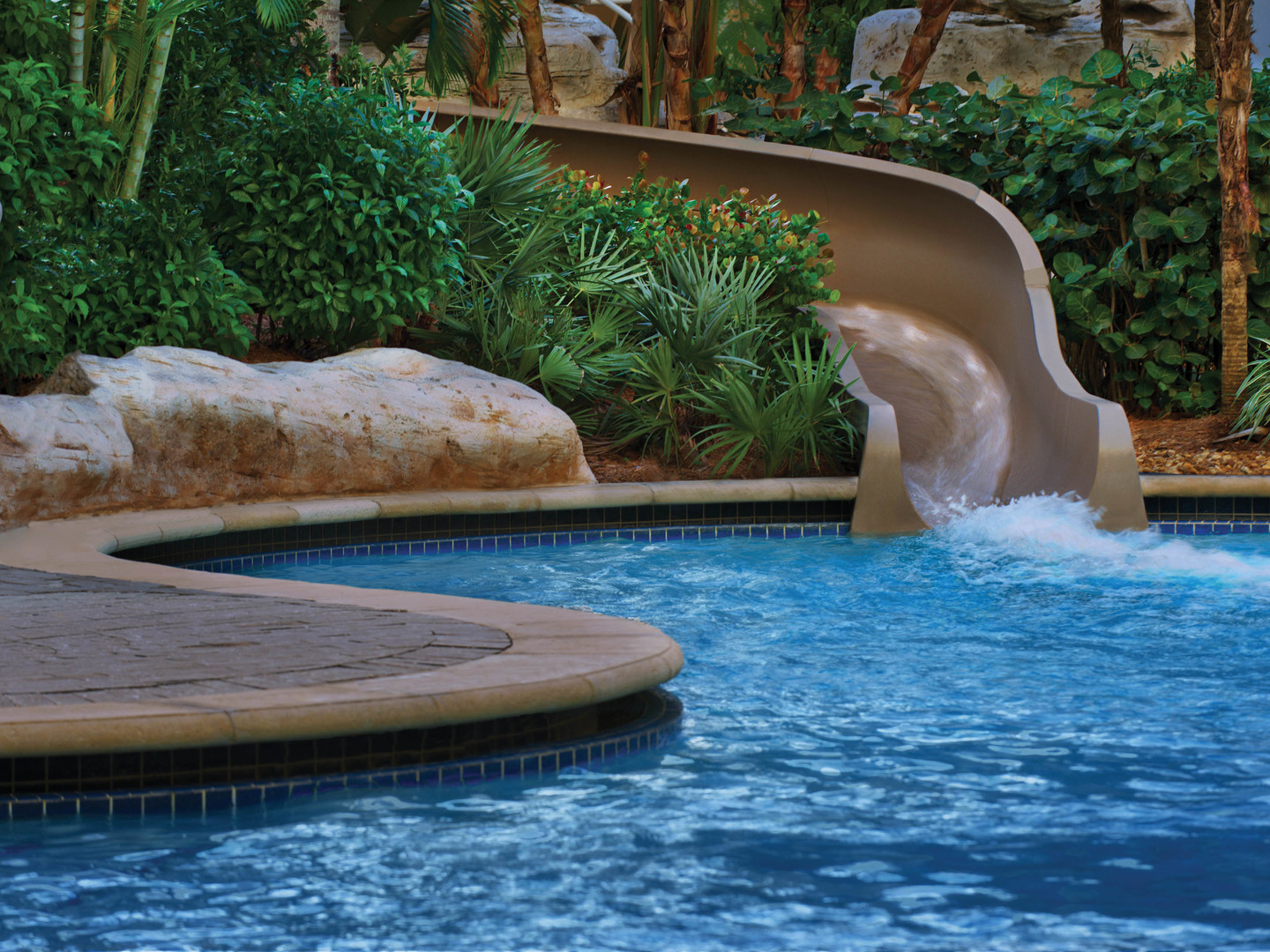 Marriott's Crystal Shores Grotto Pool and Slide. Marriott's Crystal Shores is located in Marco Island, Florida United States.