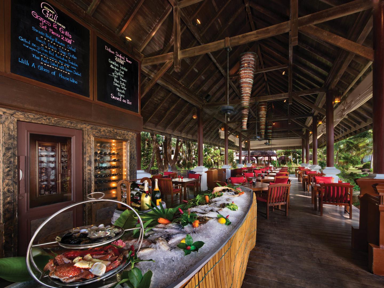 Marriott's Phuket Beach Club Andaman Grill. Marriott's Phuket Beach Club is located in Mai Khao Beach, Phuket Thailand.