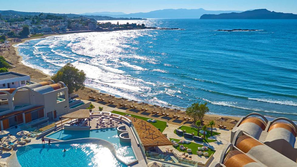 View overlooking Domes Noruz Chania hotel's pool and beach, part of the Autograph Collection.